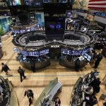Traders work on the floor of the New York Stock Exchange following its reopening